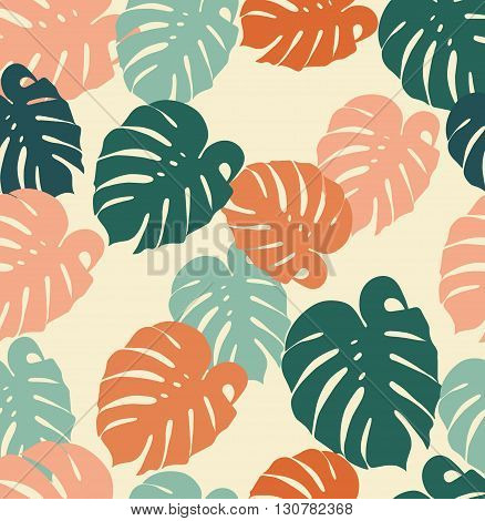 seamless pattern tropical monstera leaves on a beige background