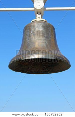Monument bell over blue sky in Odessa seaport. Ukraine