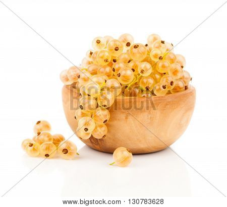 White currant fruit in a wood bowl isolated over white background.