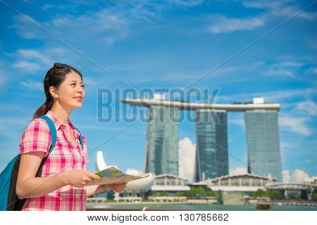 Happy Asia Woman Travel In Singapore, Marina Bay Sands Hotel