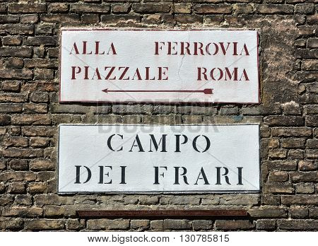 Campo dei Frari (Friars Square) and Railway Station on a Venice traditional road sign