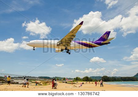 PHUKET - MAY 5 : Thai Airways airplane landing at Phuket International airport runway near the beach on May 5 2016 Phuket Thailand.