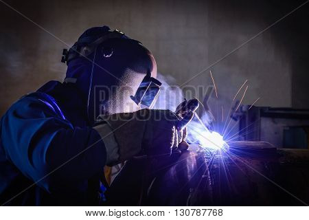 Welding steel structures and bright sparks in factory