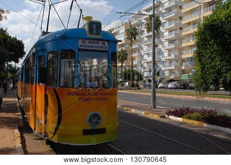 ANTALYA/TURKEY-OCTOBER 18: City tramway on the rail with Antalya International Golden Orange Logo.October 18, 2014-Antalya/Turkey