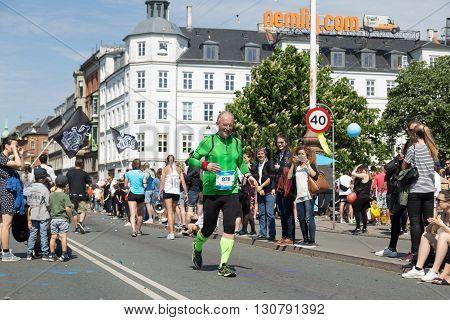 Copenhagen, Denmark - May 22, 2016: An elderly runner at the yearly event Copenhagen Marathon.