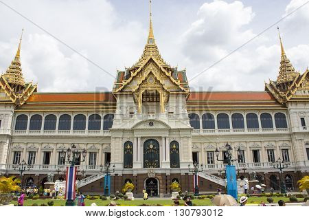 BANGKOK, THAILAND - AUGUST 21, 2014: Unidentified people by the Grand Palace in Bangkok. It is a complex of buildings at the heart of Bangkok and has been the official residence of the Kings of Siam since 1782.