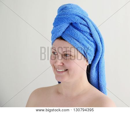 adult woman after shower with a towel on his head