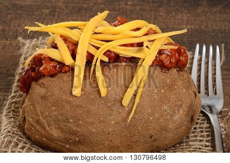macro chili cheese baked potato with a fork