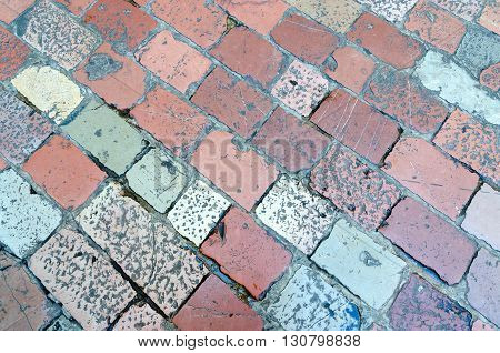 The pavement of the old multi-colored stone