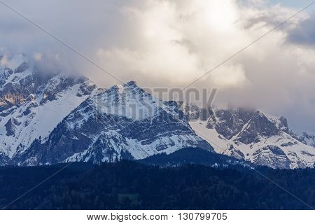 Landscape of snowy Alpine peaks shown in close-up in the light of the evening
