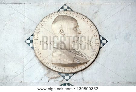 LUCCA, ITALY - JUNE 06, 2015: Medallion, in marble, representing Giovanni Pietro da Avenza; the work is located on the Portico of the Cathedral of S.Martino in Lucca, Italy, on June 06, 2015
