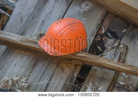 Lost place with orange safety hard hat