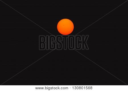Bright big sun on the black sky background