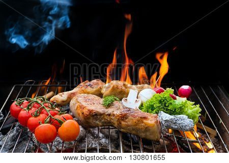Grill concept. Assorted delicious grilled meat with vegetable over the coals on a barbecue