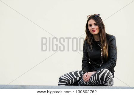 Portrait of a pretty woman sitting outdoors