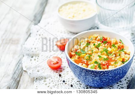 red pepper cilantro corn millet on white wood background