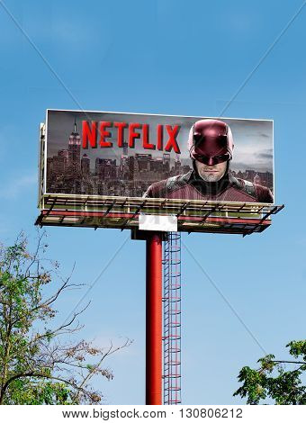 BARCELONA SPAIN - 11 OCTOBER 2016: Netflix publicity on high Billboard with blue sky background Netflix is a provider on-demand streaming media