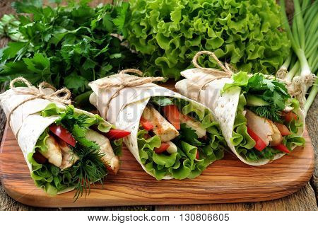 Tortilla roll with grilled chicken, tomato, cucumber, peppers, lettuce.