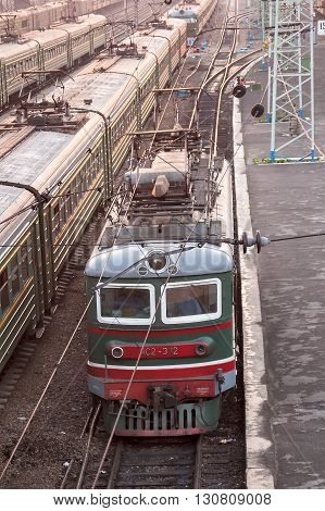 Novosibirsk, Russia - July 26, 2005: Railway station and railway tracks at evening sun