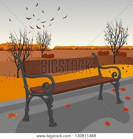 Empty wooden bench in the city park in autumn