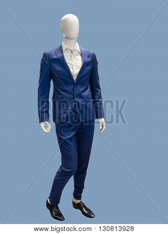 Male mannequins dressed in blue suit isolated. No brand names or copyright objects.