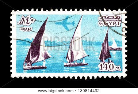 EGYPT - CIRCA 1981 : Cancelled postage stamp printed by Egypt, that shows Plane over boats on Nile.
