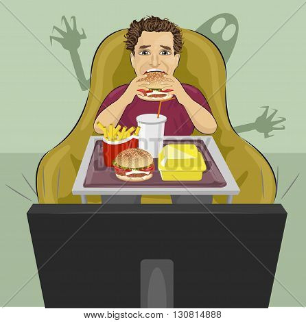 mature man sits in a chair eating hamburger and watching a horror movie on TV