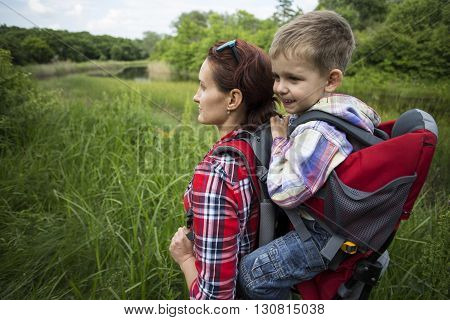 Mom With A Child Walking In The Mountains.