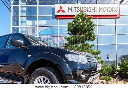 SAMARA RUSSIA - MAY 14 2016: New car Mitsubishi Pajero Sport parked up near the office of official dealer Mitsubishi. Mitsubishi Motors Corporation is a multinational automotive manufacturer
