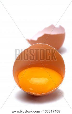Macro shot broken egg isolated on white background