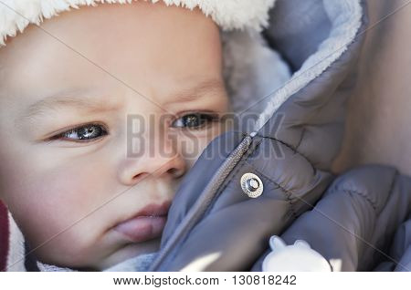 Portrait Of Cute Little Baby Boy Wearing Warm Winter Hat And Clothes.
