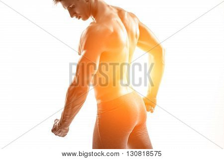 Close-up strong bodybuilder man posing with perfect abs, houlders, biceps, triceps and chest. Isolated on white background Whith solar flare
