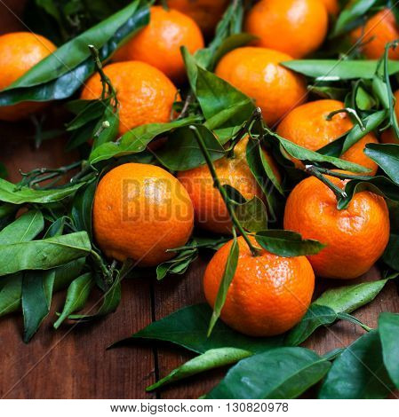 Tangerines on old wooden table close up