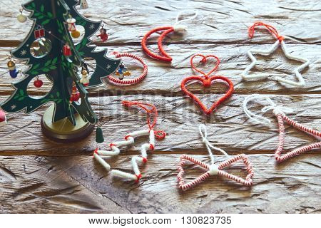 Christmas toys on a wooden table with tree