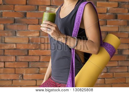 Woman in a yoga studio ready for class