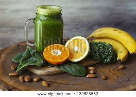 Spinach, kale, oranges, bananas, and almonds with a green juice