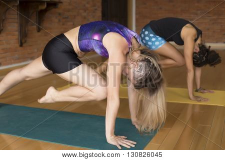 Two woman practicing yoga together