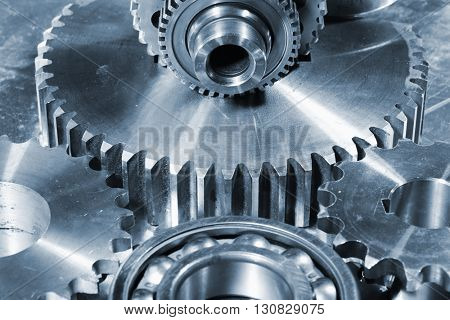 giant cogs and gears made of titanium and steel