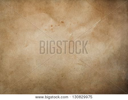 Antique parchment background. Natural old paper texture for the design.