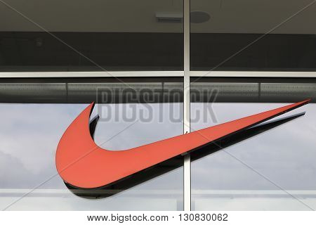 Milan, Italy - April 15, 2016: Nike logo on a facade of a store. Nike is an American company specializing in sports equipment based in Beaverton, Oregon, USA