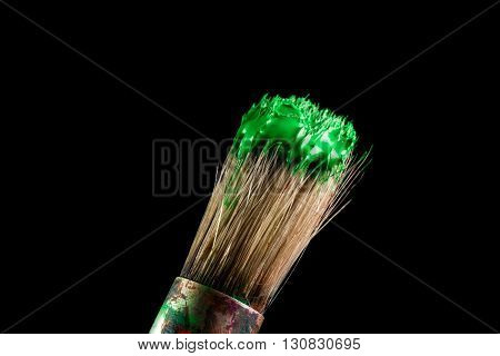 paint brush painting with green color on black background