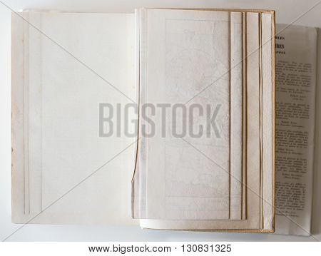Old book opened to the last page showing aged textured paper inside.