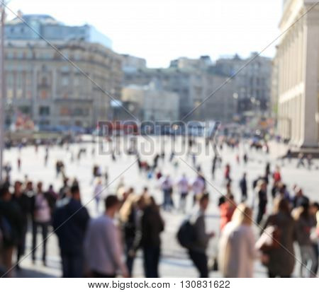 Blurred crowd of turists on big historical square in city center of Moscow. Spring warm time