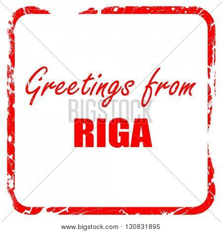 Greetings from riga, red rubber stamp with grunge edges