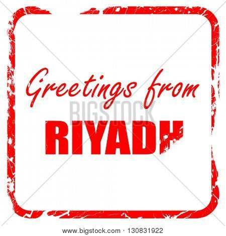 Greetings from riyadh, red rubber stamp with grunge edges
