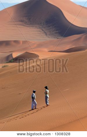 Two People Speaking In The Desert