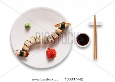 Japanese food restaurant, sushi unagi gunkan roll plate or platter set. Chopsticks, ginger, wasabi and soy sauce. Sushi with eel at white round plate isolated at white background.