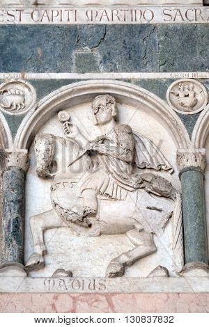 LUCCA, ITALY - JUNE 06, 2015: May, detail of the bas-relief representing the Labor of the months of the year, portal of the Cathedral of St Martin in Lucca, Italy, on June 06, 2015