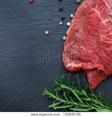 Fresh raw beef from the farmers market on a black grunge table. Selective focus, flat lay, copy space