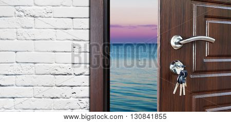 Entrance door half opened to the sea background. Vacation, holidays, freedom concept. Door handle, door lock. Exit outdoors. Opening door.